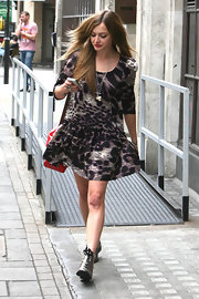 Fearne showed off her printed day dress, which she paired with lace up ankle boots.