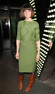 Gizzi Erskine chose a moss green dress with three-quarter-length sleeves for her mod-inspired look.