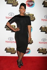 Fantasia Barrino partnered her body-hugging dress with a pair of strappy peep-toe pumps.