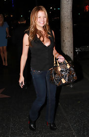 Dana Wilkey hit Katsuya in a low-cut black top and classic bootcut jeans.