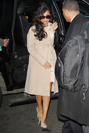 Cheryl Burke opted for a printed coat and matching nude platform peep-toe pumps.