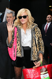 Lacey Schwimmer waved to fans wearing her classic black Ray-Ban wayferer sunglasses.