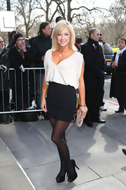 Gemma Bissix opted for a black and white look with this black mini skirt and white loose blouse.