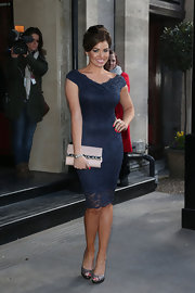Jessica Wright showed off her curves in this navy lace dress with off-the-shoulder sleeves.