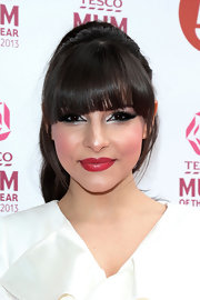 Roxanne Pallette showed off her thick brown locks with a high ponytail and blunt bangs.