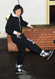 One Direction's Harry Styles stays warm in these ankle high boots.