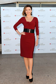Dannii Minogue added a wide leather belt to her silky red dress at the V Australia.