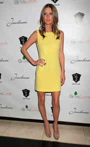 Nicky Hilton topped off her yellow shift dress with embellished peep-toe pumps.