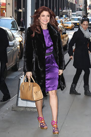 "Debra Messing wore a hot purple cocktail dress for her appearance on 'Live! With Kelly"" in NYC."