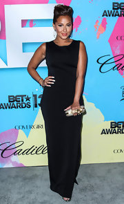 Adrienne Bailon wore this sleek and sophisticated black sleeveless dress to the Pre-BET Awards Celebration Dinner.
