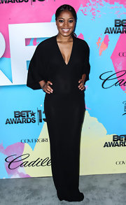 Keke Palmer rocked a black V-neck draped dress at the Pre-BET Awards Celebration Dinner.