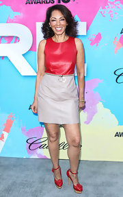 Debra chose a red and tan sleeveless leather dress for her edge but still classic look at the Pre-BET Awards Celebration Dinner.