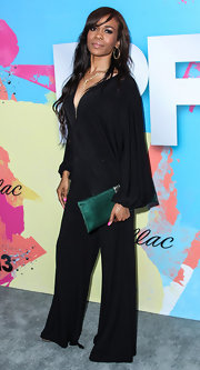 Michelle Williams chose a flowing, '70-style black jumpsuit for her retro look at the Pre-BET Awards Celebration Dinner.