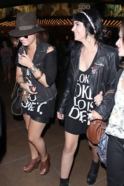 Demi Lovato was spotted hitting the movies at The Grove in tan leather peep-toe booties and an oversize graphic tee.