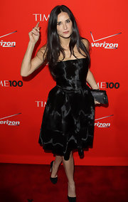 Demi Moore looked exquisite in a black strapless cocktail dress with a light-catching sheen at the Time 100 Gala.