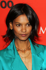 Liya Kebede finished off her look with a chic layered gold necklace.