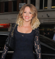 Kimberley Walsh added some brightness to her look with a swipe of coral lipstick.