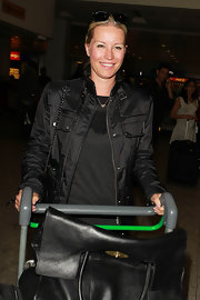 Denise van Outen was spotted at Heathrow Airport wearing an effortless but chic ensemble featuring a biker jacket.