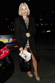 Denise van Outen matched her dress with a pair of nude peep-toe pumps.