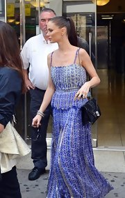 Georgina looked boho-beautiful in this airy purple print maxi-dress while out in NYC.