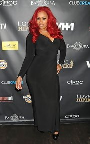Rashida vamped it up in this long-sleeve black evening dress and bright crimson locks.