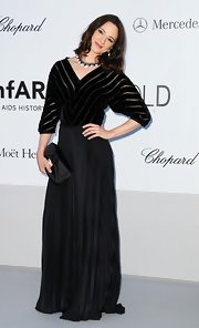 Asia Argento arrived at the amfAR Gala wearing a floor-length pleated skirt and a loose striped top.