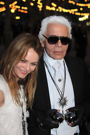 Karl paired his leather fingerless gloves with black aviator shades.