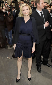 Kirsten Dunst wowed at the Chanel Haute Couture fashion show in black satin pointy pumps with translucent heels.