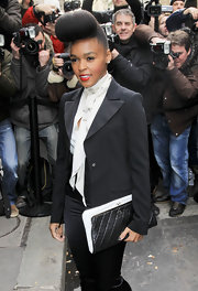 Janelle Monae accented her signature tuxedo look with a black and white quilted leather Chanel clutch.