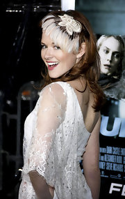 Sarah Drew wore a classy feathered fascinator to the Los Angeles premiere of 'Unknown.'