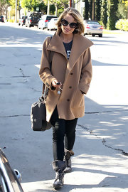 A low-key Dianna Agron hit the salon in an oversize camel pea coat.