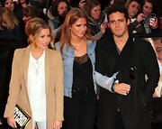 Caggie Dunlop carried a unique printed clutch at a premiere night with friends.