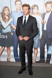 Simon Baker chose a classic gray suit for his look at the 'I Give it a Year' premiere in Paris.