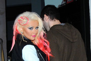 'Dirty' singer Christina Aguilera sports a dip-dye do as she heads to a late dinner with boyfriend Matthew Rutler at Osteria Mozza after an appearance at the Grove in Los Angeles. The pair were joined at Osteria Mozza by country singer star Blake Shelton and his mother Dorothy.