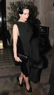 The always stylish Dita Von Teese added polish to her elegant attire with a black leather Belle De Jour clutch.