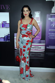 Dita rocked a retro-cool look with this blue and red rose-print dress.