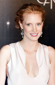 Jessica Chastain attended a screening of 'Moonrise Kingdom' wearing her hair in a loose romantic updo featuring subtle waves.