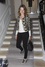 Natalia Vodianova added modern exoticism to her look at the Christian Dior show with a cropped snakeskin jacket.