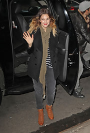 Drew Barrymore topped off her casual look with a classic black pea coat.