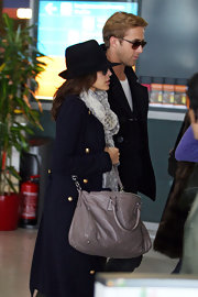 Eva Mendes met up with boyfriend Ryan Gosling in Paris wearing a casual black wide-brimmed hat.