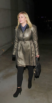 Elisha Cuthbert was spotted in a stylish metallic trenchcoat while attending a Katy Perry concert in LA.