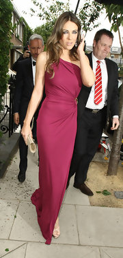 Elizabeth Hurley looked elegant as ever when she sported this one-shouldered deep fuchsia gown.