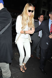 Elle MacPherson maintained her sleek white style with an embroidered cardigan.
