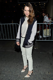 Emilia Clarke chose a varsity-style letterman's jacket for her cool and casual look while leaving the Cort Theater.