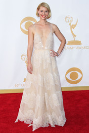 Claire shimmered in a cream spaghetti-strapped gown with a plunging neckline, tulle bodice, and delicate detailing throughout.