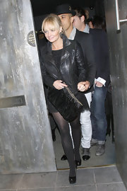 Emma wore all black when she stepped out for the night. The former Spice Girls carried a gathered, oversized clutch.