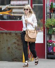 Emma kept her street look cool and clean with a pair of crisp black slacks.