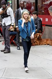 Emma Stone dressed up her printed blouse with this bright blue blazer.