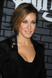 Sarah Jessica Parker added a little sparkle to her Vivienne Westwood dress with a decadent brooch.