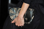 Sarah Jessica Parker paired her Vivienne Westwood dress with a sequin embellished clutch, which was the perfect match.